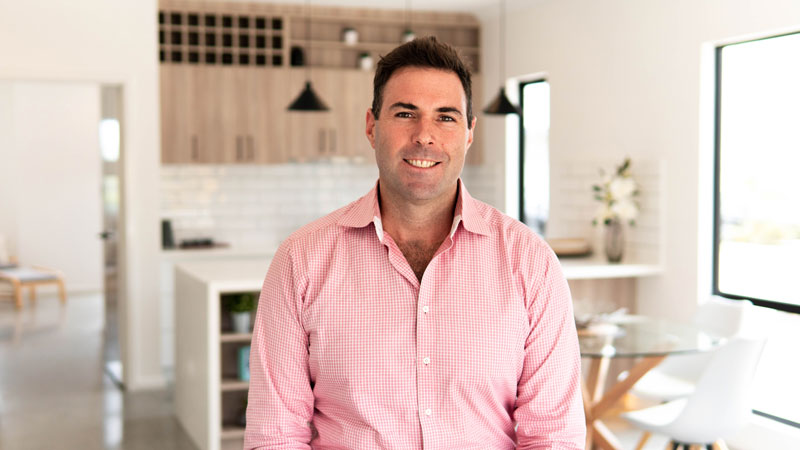 Nick Berry the managing director in a modular home with a pink shirt