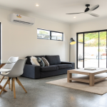 The living area of a modular home with a polished concrete floor.